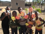 kids bible school proudly showing crafts